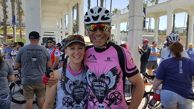 Swiss skiing champion, Philippe May, smiles in a photo with his wife prior to a Race Across the West ultra-cycling race.