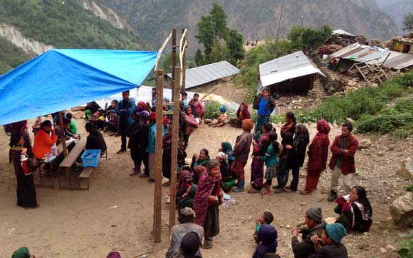 Scripps Health Medical Response Team members provide care at a temporary medical clinic set up in a remote Nepal village damaged by the recent earthquakes. (Photo credit: Scripps Health) View high-resolution image