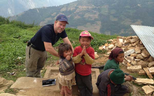 Scripps Health Medical Response Team member Tim Collins poses with children in a remote Nepal village damaged by the recent earthquakes. (Photo credit: Scripps Health) View high-resolution image