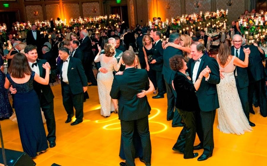 Attendees of the Annual Candlelight Ball gather on the dancefloor as Scripps rings in the holiday season.