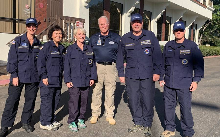 Scripps CEO, Chris Van Gorder (center) with Scripps medical response team members as they prepare to leave for the Camp Fire.