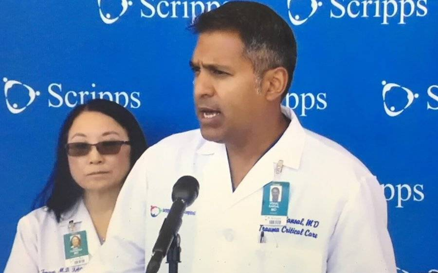 Two Scripps doctors at a press conference talk about responding to a mass shooting in nearby University City.