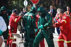 San Diego Fire Department hazardous materials team members slip into special suits in preparation for washing down a mock bio-terrorism attack victim.