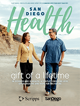 The cover of the December issue of San Diego Health magazine shows a San Diego couple walking on the beach.