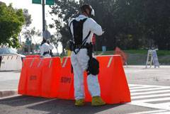 San Diego Police Department decontamination team member monitoring traffic during the Golden Phoenix training event at Scripps La Jolla.