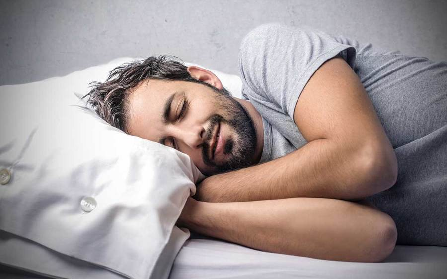 A man diagnosed with sleep apnea attempts to get a good night's sleep.