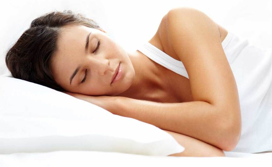 A woman gets a good night's rest following successful somnoplasty treatment.