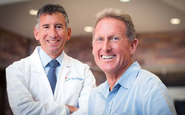Distance runner Steve Scott is pictured with his physician, Dr. Carl Rossi of Scripps Proton Therapy Center.
