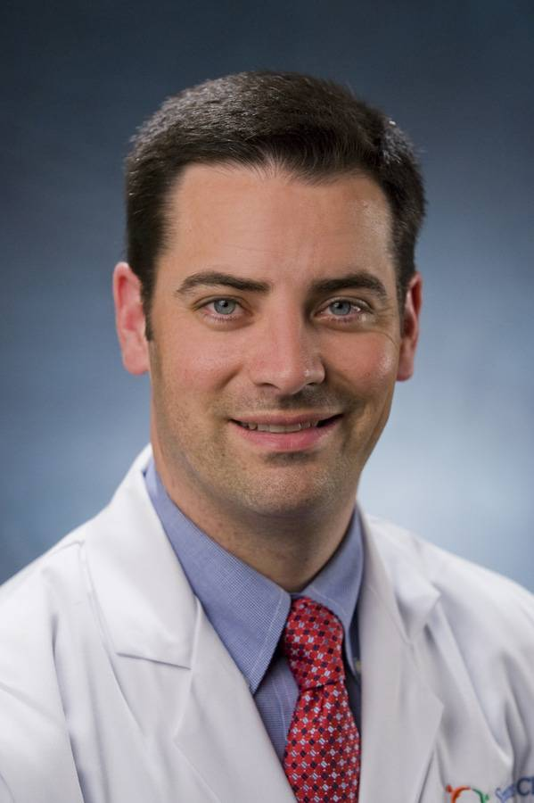 Dr. Curtiss Stinis, MD