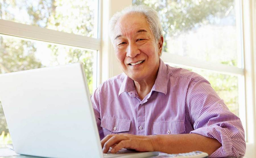 A smiling mature Asian man represents the full life that can be led after stomach cancer treatment.