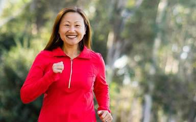 Personal trainer Christine Burke runs in a San Diego park after hip replacement surgery at Scripps relieves her chronic hip pain.