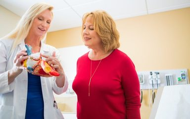 Christina Adams, MD, cardiologist at the Scripps Women's Heart Center at Scripps Memorial Hospital La Jolla, uses visuals to explain heart disease to patients.