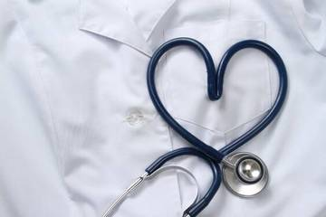 Stethoscope on top of white lab coat, symbolizing heart health.