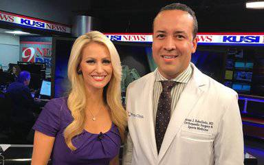 KUSI anchor Lauren Phinney and Scripps Clinic Dr. Brian Rebolledo at KUSI studio after interview on sports-related orthopedic injuries.
