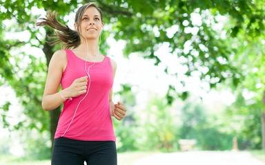 Young woman jogging with earphones.