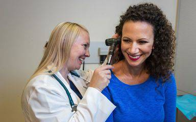 A Scripps Health provider  checks the ear of a Scripps patient at one of its HealthExpress Walk-In clinics.