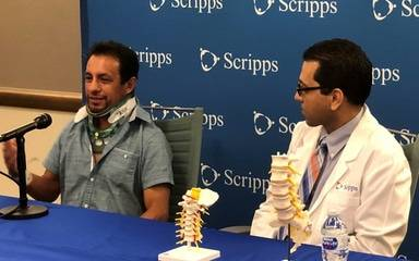 Hall of Fame jockey Victor Espinoza who was discharged from a Scripps hospital recently after surviving a bad fall, and Jihad Jaffer, MD, Scripps Encinitas rehabilitation specialist, speak during a news conference.
