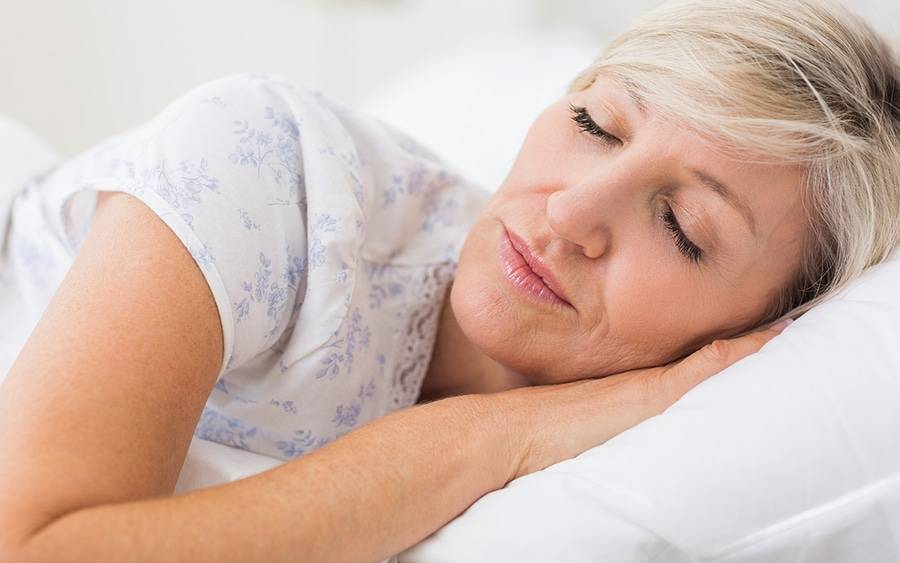 Middle age caucasian woman sleeping in bed