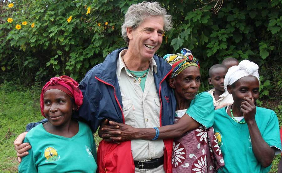 Scripps cardio patient Bill Toone stands with group of people in Africa.