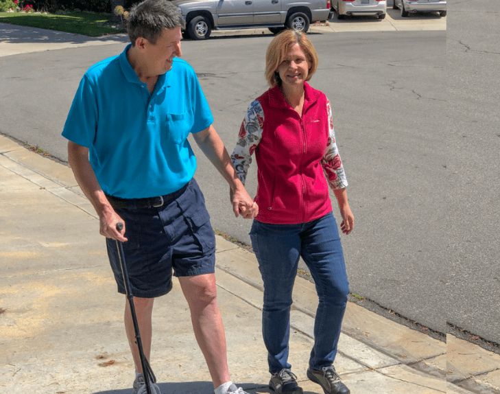 Chula Vista man walks with aid of a cane and his wife after undergoing surgery to remove bone tumor.