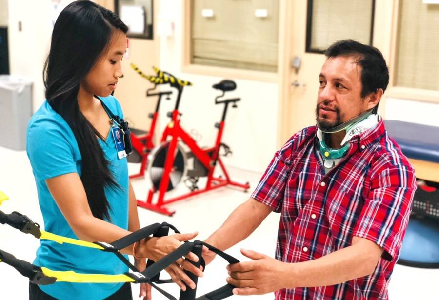 Victor Espinoza works with a physical therapist on his road to recovery following a spine injury.