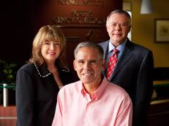 Mary and Gary West (standing) with Eric J. Topol, M.D. (center).