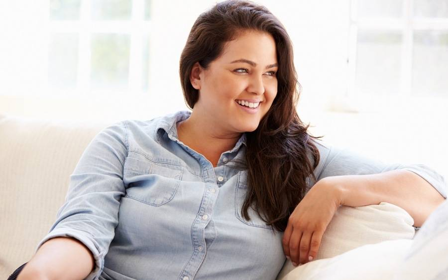 Woman smiling after recovering from gastric sleeve procedure.