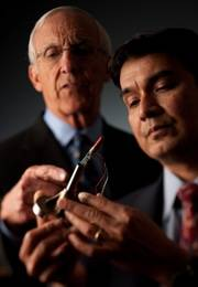 Dr. Clifford Colwell and Dr. Darryl D'Lima (right) examine the e-knee technology.
