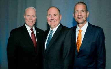 Scripps Health President and CEO Chris Van Gorder, Thomas Buchholz, medical director Scripps MD Anderson, and James LaBelle, Scripps Health chief medical officer posed together at the 2018 Spinoff event that raised $2.4 million for cancer care.