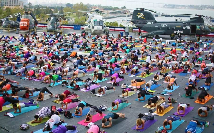 Yoga enthusiasts at Yoga on Midway presented by Scripps Health